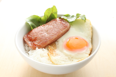 luncheon meat and sunny side up on rice 写真素材
