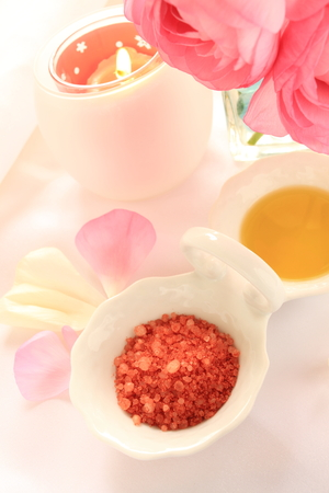 rock salt: rock salt and oil with aroma candle for massage image Stock Photo