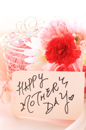 hand written: artificial flower and hand written Mothers day greeting care Stock Photo