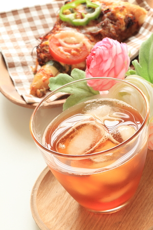 belly pepper: beef and tomato pizza and iced tea Stock Photo