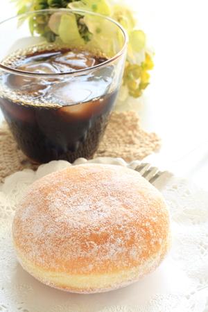 iced coffee: iced coffee and donut Stock Photo