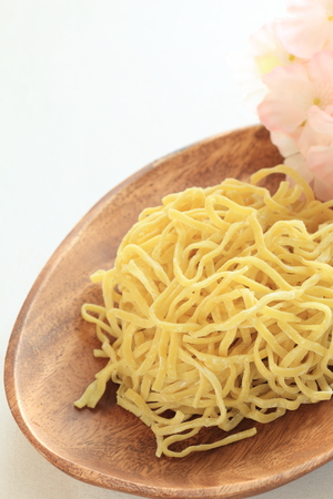 egg noodles: Chinese food ingredient, egg noodles on plate Stock Photo