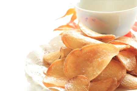 Japanese sweet potato chips and tea Stock Photo