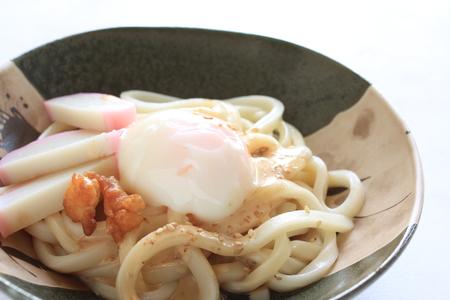 dashi: hot spring egg on Udon noodles Stock Photo