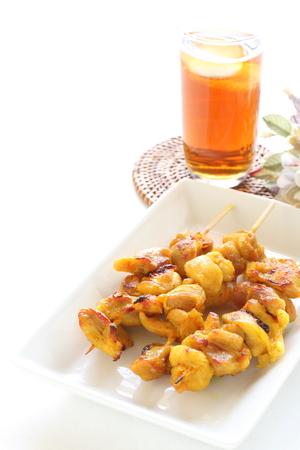 chicken satay: Indonesian food, chicken satay and tea