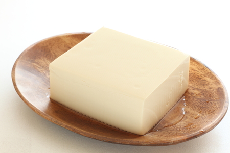 wooden plate: Tofu on wooden plate Stock Photo