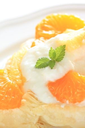 mandarine: close up of mandarine orange and yogurt on pie Stock Photo