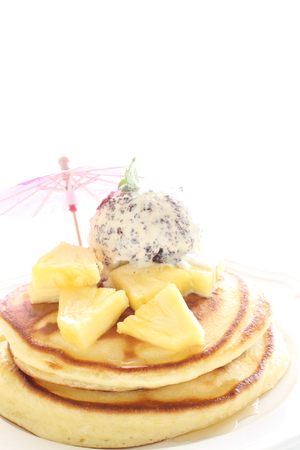 pan tropical: pineapple and ice cream on pancake Stock Photo