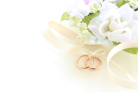 golden wedding rings on fabric