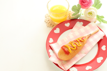 corn dog with mustard sauce Stock Photo
