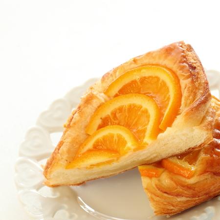 half  cut: half cut orange pastry