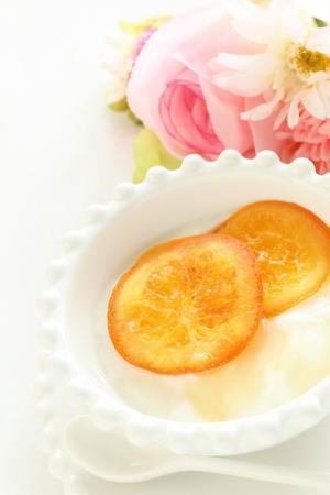 dried orange: dried orange and honey yogurt Stock Photo