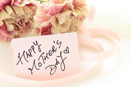 Single flower, carnation with hand written card
