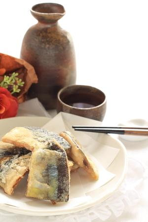 deep fried: Deep fried pacific saury and Japanese wine Stock Photo