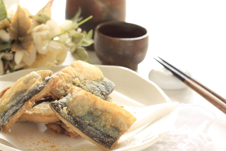 Deep fried pacific saury and Japanese wine Stock Photo