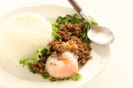 Japanese fusion food, dried curry and poach egg Stock Photo
