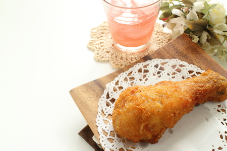 fried chicken drumstick and drink