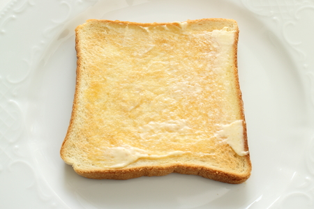 toast and butter on dish