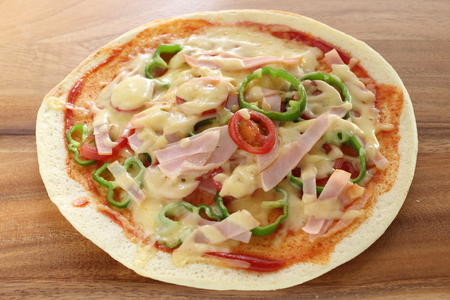 close up of ham and tomato pizza Stock Photo