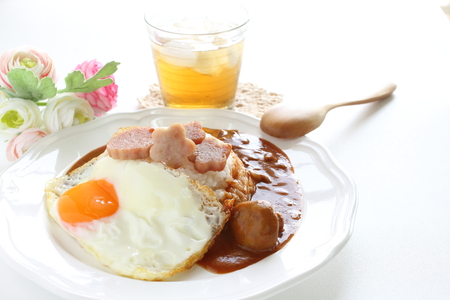 flower shaped luncheon meat on rice with Demi-glance sauce