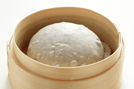 Chinese food, sesame bun in bamboo steamer and tea