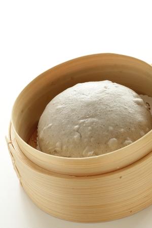 Chinees eten, sesambroodje in bamboestoomboot en thee