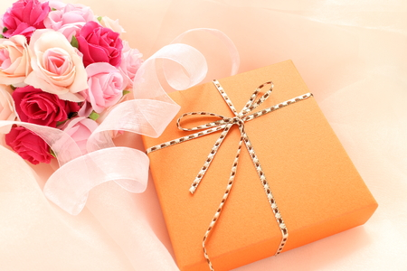 orange color gift box with flower bouquet