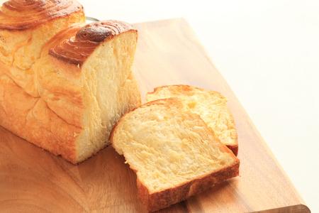 オレンジのデニッシュ食パンします。 写真素材
