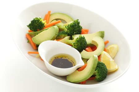 carrot and broccolli salad with dressing Stock Photo - 86231290