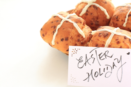 Homemade cross bread and written easter card