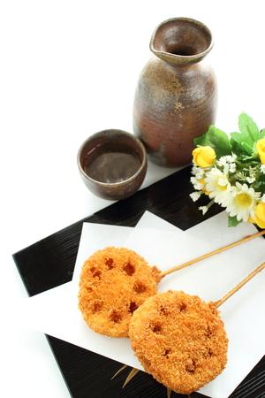 Japanese food, deep fried lotus root with bamboo skewer