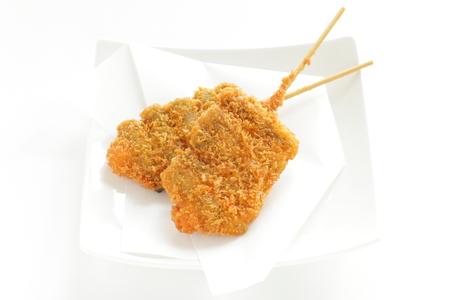 Japanese food, deep fried asparagus with bamboo skewer