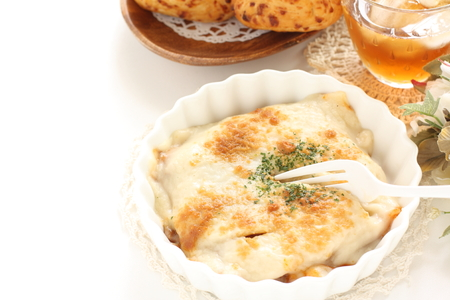 white sauce gratin with herbal on top