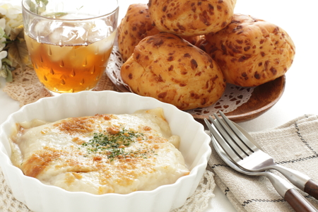 homemade white sauce gratin and bread Stock Photo
