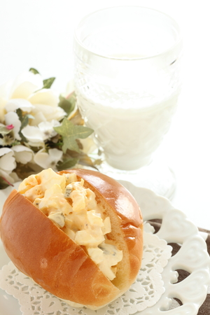 Egg and mayonnaixe in butter roll with milk Stock Photo