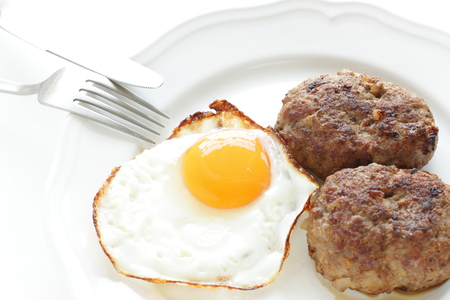 Sunny side up fried egg and homemade patty