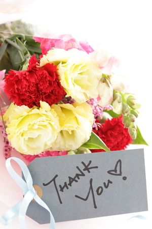 Thank you card and carnation flower bouquet