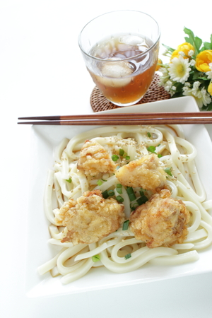 Japanese food, fried chicken on undon noodles and tea