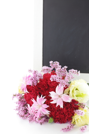 Flower bouquet and black board