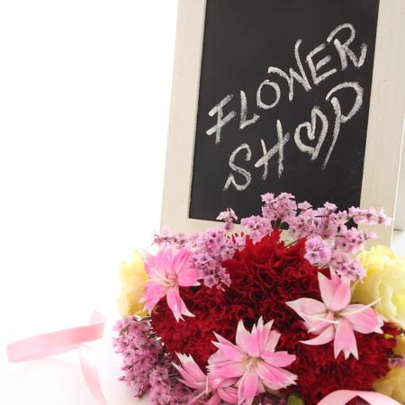 hand written flower shop blackboard with bouquet
