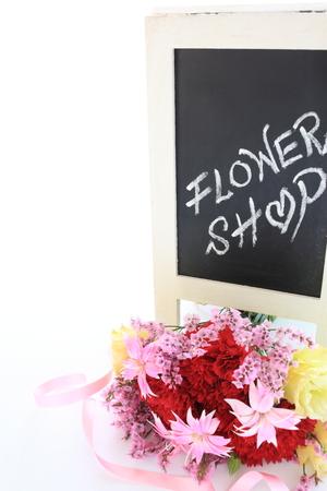 chalk written Flower shop in blackboard with bouquet
