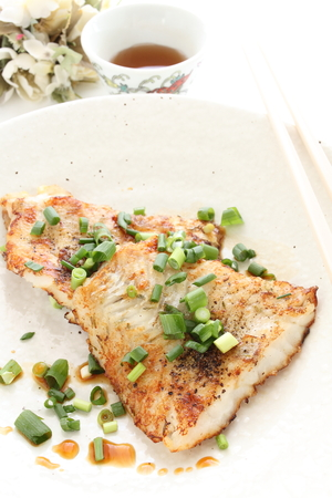 Chinese food, pan fried white fish and scallion