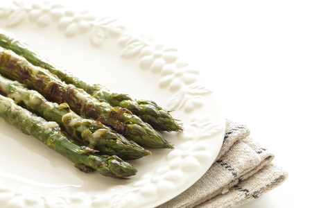 Grilled asparagus on dish for gourmet food image