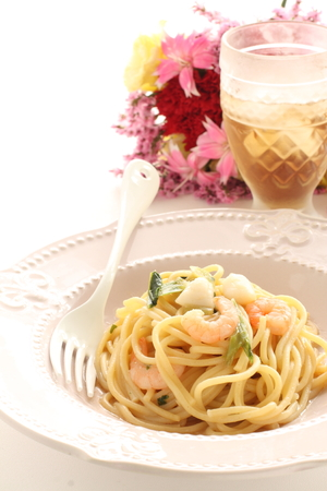 Italian food, green leaf vegetable and seafood spaghetti Stock Photo