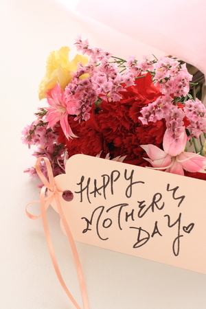 Carnation bouquet and hand written Mothers day card