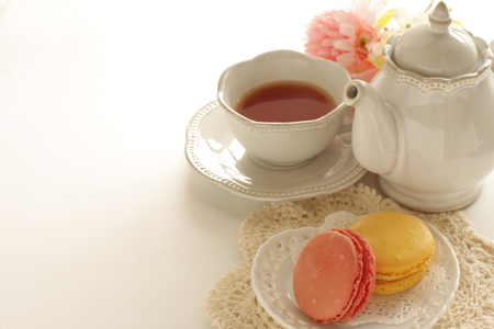 Pastel color confection, french food Macaron and tea