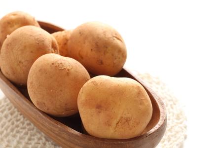Freshness new potato on wooden bowl