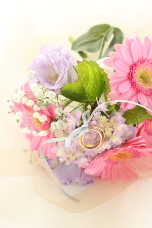 Pink daisy and purple hydrangea with wedding ring Stock Photo