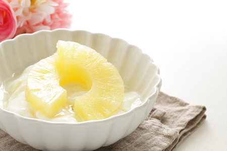 Pineapple and yogurt with flower Stockfoto