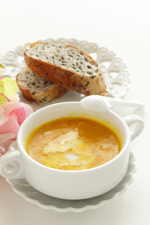 sour cream and pumpkin soup with bread 写真素材